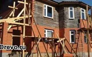 Как правильно обложить дом из бруса кирпичом
